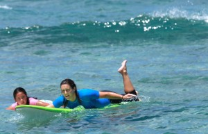 kaily_surf_lesson_ocean_girl_project_surfstainable_surf_camps_