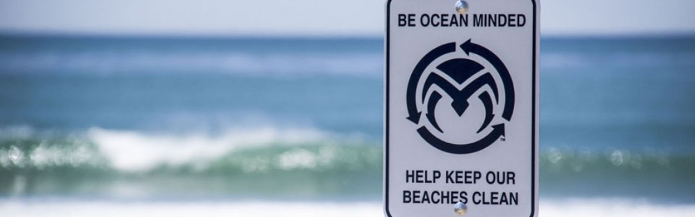 cropped-om_beachsign_uppers.jpg