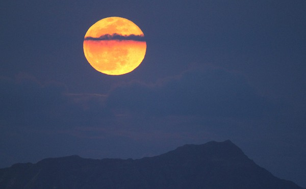 The full moon seen over Diamond Head, Honolulu, Hawaii.